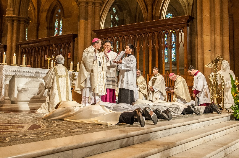 Ordinands lay prostrate during the 31 October ordination Mass at St Mary's Cathedral. Photo: Giovanni Portelli